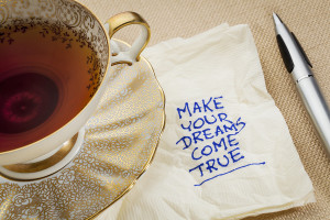 make your dreams come true - motivational slogan on a napkin wit