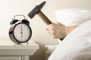 bigstock-Smashing-Alarm-Clock-with-Hamm-11945420