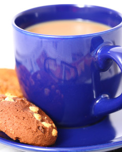 Cup Of Coffee And A Couple Of Cookies Making A Welcome Break